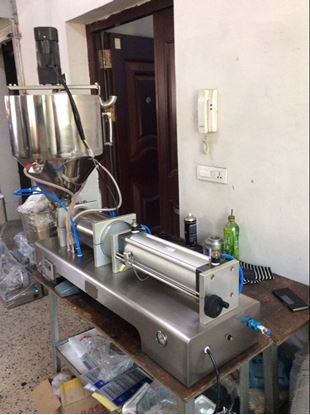 Picture of paste filling machine with the heated and mixer hopper 15-150ml